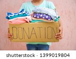 girl holding donation box with... | Shutterstock . vector #1399019804