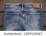 blue jeans pocket on wooden... | Shutterstock . vector #1399110467