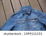 close up front view denim blue... | Shutterstock . vector #1399111151