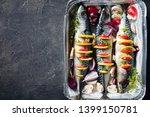 three whole raw mackerel with...