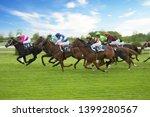 Stock photo race horses with jockeys on the home straight shaving effect 1399280567