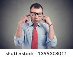 annoyed man looking grumpy... | Shutterstock . vector #1399308011