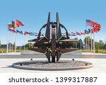 Small photo of BRUSSELS, BELGIUM - May 13, 2019: Nato star sculpture in Brussels. NATO Headquarters - Political and Administrative Center for the North Atlantic Alliance