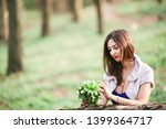 beautiful girl looks at anemones | Shutterstock . vector #1399364717