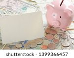 United States bank notes and coins with a calcultor, piggy bank, and a blank card