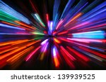 Abstract pattern of red and blue light stripes formed from zooming out during long exposure of electric bulbs on a black background - stock photo