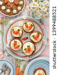 carrot cupcakes with mascarpone ... | Shutterstock . vector #1399488521