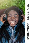 young african woman laughing... | Shutterstock . vector #1399576607