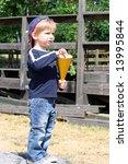 Kid eating popcorn - stock photo