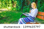 woman with laptop works outdoor ... | Shutterstock . vector #1399635797