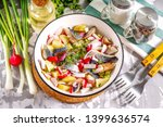 Stock photo salad of salted herring boiled potatoes and radish in a bowl on a white background 1399636574