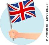 united kingdom flag in hand.... | Shutterstock .eps vector #1399718117