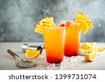 tequila sunrise cocktail with... | Shutterstock . vector #1399731074