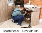 male plumber in uniform... | Shutterstock . vector #1399984784