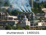 Factory chimney pipes polluting the air with smoke - stock photo
