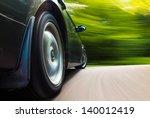 rear side view of black car in... | Shutterstock . vector #140012419