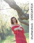 beautiful young woman wearing... | Shutterstock . vector #1400169314