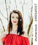 beautiful young woman wearing... | Shutterstock . vector #1400169317