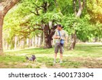 Stock photo happy dogs walking outdoors and enjoying with dog walker 1400173304