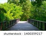 old wooden bridge in country... | Shutterstock . vector #1400359217