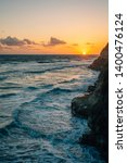 sunset over rocky coast and the ... | Shutterstock . vector #1400476124