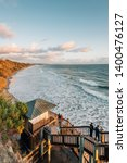 staircase and the pacific ocean ... | Shutterstock . vector #1400476127