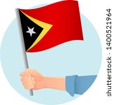 east timor flag in hand.... | Shutterstock .eps vector #1400521964