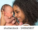 smiling african mother holding... | Shutterstock . vector #140065837