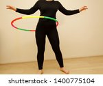 female is hula hooping. home... | Shutterstock . vector #1400775104