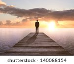 Businessman Standing On Wooden...