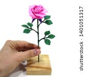 Stock photo origami paper pink rose with green leaf for love concepts of valentine s day holidays on white 1401051317