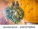 birch brooms hang against the... | Shutterstock . vector #1401076844