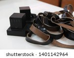 Small photo of pair Tefillin -[phylactery] with black straps on a with White background