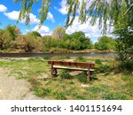 An Isolated Wooden Brown Bench...