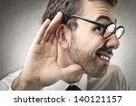 curious businessman listens | Shutterstock . vector #140121157