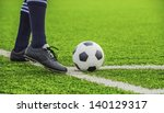 soccer ball with his feet on... | Shutterstock . vector #140129317