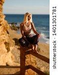woman enjoying the sunset on a... | Shutterstock . vector #1401301781