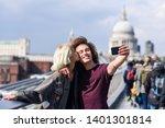 happy couple taking a selfie... | Shutterstock . vector #1401301814