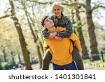 funny couple in a urban park.... | Shutterstock . vector #1401301841