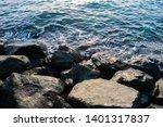 Blue Water Splashing On A Rock...