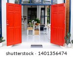 Wide Open Red Door Into Cafe...