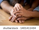 Small photo of Close up of loving family stack hands on warm floor together show support and unity, caring parents join arms with child express devotion loyalty understanding. Bonding, good relationships concept