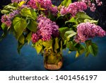 a bouquet of lilacs in a glass... | Shutterstock . vector #1401456197