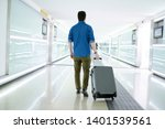 back view of man with carry on... | Shutterstock . vector #1401539561