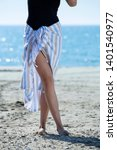 the girl stand on the beach and ... | Shutterstock . vector #1401540977