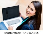 casual woman working on a... | Shutterstock . vector #140164315