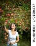 cute young woman picking apples ... | Shutterstock . vector #1401686867