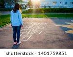 Cute Girl Playing Hopscotch....