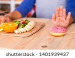 Small photo of woman don't want hear talking of donut or any type of rubbish food and bad food - she prefer fruit and vegetable to be happy with herself and to see she better - great lifestyle