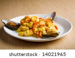 paella with oyster on the white plate - stock photo
